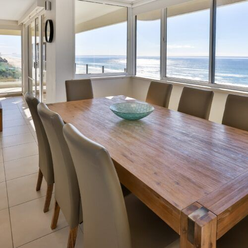 Open plan dining with beachfront view apartment 13