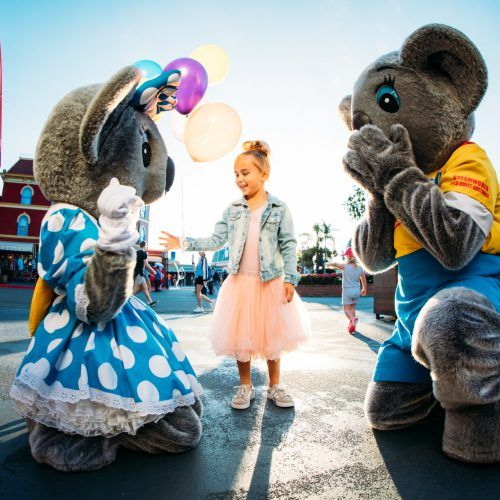 gc-tourism-dreamworld-little-girl-in-pink-tutu-with-belinda-koala-with-kenny-koala